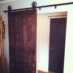 Reclaimed Barn-Door with Vintage steel tracking by JSReclaimedWood