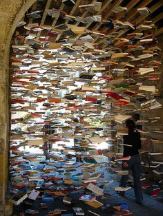 Suspended books sculpture.  Maybe not a practical upcycle, but if you have the space, well, go for it.