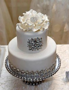 Pretty, just enough sparkle. White wedding cake with silver sparkle
