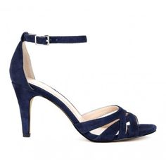 Open toe sandal in genuine materials. Features ankle strap and cutout details.Great color