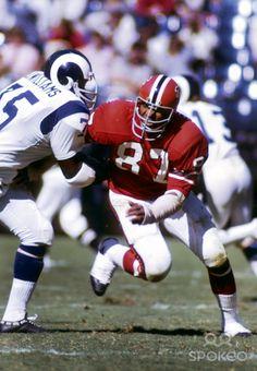 Atlanta Falcons defensive end Claude Humphrey (87) flights of a block by Los Angeles Rams tackle John Williams (75) at Fulton County Stadium...