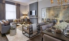 Open plan living room and dining room in the Notting hill project in grey and gold