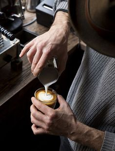 coffee / barista pouring latte art (remain simple)