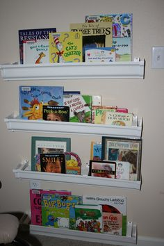 Very clever idea to keep your books organized and clean up fun for the kids . . . . Rain Gutter Book Shelves