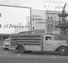 Coca-Cola truck driving around the fountain at Court Square in downtown Montgomery, Alabama. :: Alabama Photographs and Pictures Collection