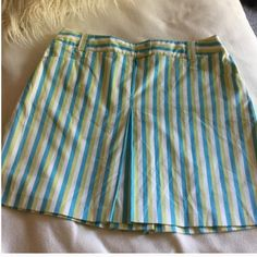 """Burberry stripe skirt Burberry stripe skirt in gorgeous turquoise, lime and white colors. Front pockets and a lightweight feel. Great for golf or weekends. Barely worn great condition. 20"""" long waist is 17"""" across front and hips are about 23-24"""" across front Burberry Skirts"""