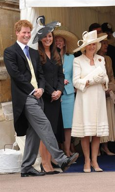 Hats off Prince Harry, Kate Middleton and Camilla, Duchess of Cornwall, laugh together as they watch the Order of the Garter procession at Windsor Castle on June 16, 2008, in Windsor, England.