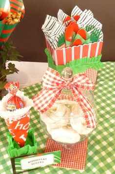 I reused the red ginham bows from my red-white-blue party as decorations for the apotecary jar (sugar dunuts) The red cuttery was displayed in a Popcorn box. I wrapped the cuttery with green paper napkinks matching with leftovers Damask and Red Ginham napking from Vintage Barbie Glam and Red-Blue and White Parties.