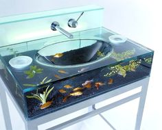 The Moody Aquarium Washbasin: definitely the perfect thing to go along with that Aquariass aquarium toilet we just ordered (plus they've even tested it to make sure that the fish won't die if you fill the sink with hot water). Only $4,900.  ONLY??!!!?  I can so afford this...NEVER! It is still cool though!