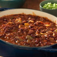 Your friends will become big fans of this hearty chili recipe, made with two types of BUSH'S® Chili Beans. Garnish with chopped green onions and sour cream for added flavor. Chilli Recipes, Mexican Food Recipes, Crockpot Recipes, Soup Recipes, Dinner Recipes, Recipies, Muffin Recipes, Pasta Recipes, Dinner Ideas