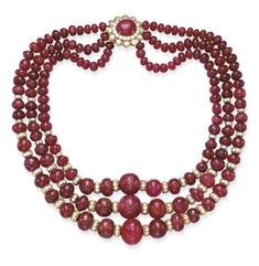 A THREE-STRAND RUBY AND DIAMOND NECKLACE, BY DAVID WEBB  Each strand composed of graduated ruby beads, the front spaced by circular-cut diamond and gold rondelles, joined by a circular-cut diamond and cabochon ruby floret clasp, mounted in 18k gold