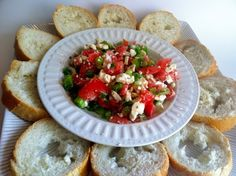 Greek Feta Dip: Olive Oil (I used EVOO),    1 pkg feta cheese  (I liked using the garlic & herb & I've also used reduced fat),    Tomatoes (any old kind will do),    1 bunch scallions,    1 baguette,    Greek Seasoning
