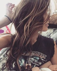 Motherhood moments: Audrina Patridge shared a snap of herself breast-feeding her baby daughter Kirra Max on Monday
