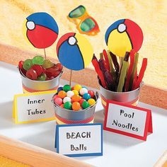 """Pool Party Favors - OrientalTrading.com  """"inner tubes"""" lifesaver candies, """"pool noodles"""" licorcie, """"beach balls""""  gumballs... too cute!"""