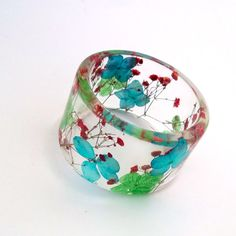Red, Blue and Green Botanical Resin Bangle.  Chunky Bangle with Pressed Flowers.  Real Flowers - Red Baby's Breath. $44.00, via Etsy.