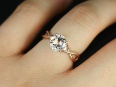 CUSTOM SILVER Round White Topaz Twisted Engagement Ring (Reserved for Emily L.). $280.00, via Etsy.