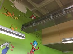 Lyngsoe conveyor runs through ceiling of children's area and into workroom. San Diego (City) Library