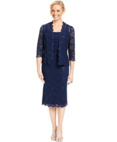 Classic lace gets a modern update on Alex Evenings' pretty dress, featuring a trendy midi length and chic navy hue. The accompanying lace jacket adds even more style. | Nylon/polyester/spandex; lining