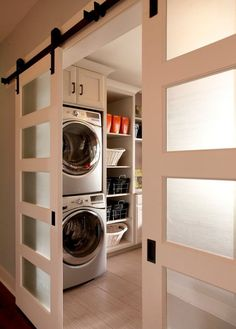 I love these doors...Stylish Laundry Room Ideas...LOVE these doors... believe we may do this when the kiddos move out