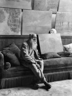 Claude Monet seated with some paintings which sold in 1880 for 1,000 francs. They were worth 100 times that at the time of the photo, most likely taken in the mid-1920s, as Monet's career was winding down and his eyesight was failing.