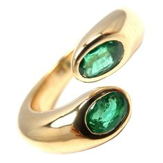 CARTIER Ellipse Deux Tetes Croisees 18k emerald ring | From a unique collection of vintage band rings at https://www.1stdibs.com/jewelry/rings/band-rings/