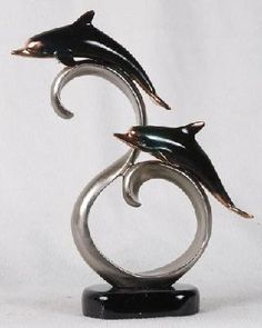Ancient Silver And Pewter Dolphins Swimming Statue