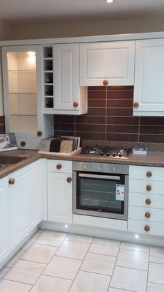 Kitchen Showrooms Online by design cannes gloss ivory kitchen with hardwood walnut worktops