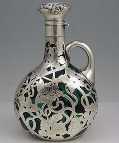 An art nouveau silver overlay decanter by the Gorham Company in 1900 (via Moz Carlson (mozcarlson) Vintage Silver, Antique Silver, Gorham Silver, Jugendstil Design, Art Decor, Decoration, Art Nouveau Design, In Vino Veritas, Objet D'art