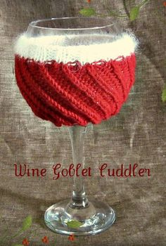 "Knitting Pattern for Wine Goblet Cuddler - This glass cozy is a ""reversible"" pattern and will fit wine glasses of several different shapes and sizes because the spiral ribbing draws inward causing the cozy to hug most forms. Although designed with the holiday in mind you could easily customize for other celebrations with different colors."