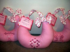 Post-mastectomy pillows with breast cancer awareness machine embroidery designs.