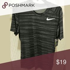 🎉Men's Nike Dri Fit Size Medium short sleeve dri fit.  Grey/ black with white swirl.  Brand new!! 15% discount on bundles.🔸Firm Price🔸 Nike Shirts