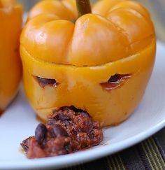Super-easy spooky spiced chili  baked in a carved bell pepper for Halloween! #halloween #vegan