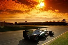 The Petronas Mercedes F1 car screams through the sunset of Albert Park - Australian GP 2013  http://www.mercedes-amg-f1.com/en/#/s/gallery/219/Der+Sonntag:+Die+besten+Bilder+aus+Melbourne