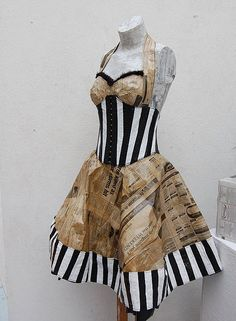 This recycled dress by Stasha Pistachio was made from used newspapers, plastic bags and garbage can liners. ...HOT!!