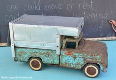 Rusty old Tonka truck.  Love the turquoise and rust combination. From MySalvagedTreasures.com
