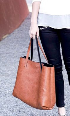 Reversible cognac & black textured shoulder tote with magnetic closure.