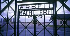 """An entrance gate with the words """"Arbeit Macht Frei"""" (""""Work Brings Freedom"""") at Dachau concentration camp."""