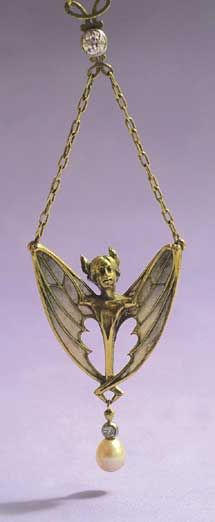 The star-fairy by Antoine Bricteux and the bat-woman by Lucien Gautrait are both pendants with diamonds, pearls and pliqué-à-jour enamel in gold. Courtesy of a private collection. Photos by Robert Weldon