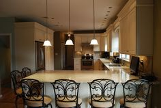 Kitchen peninsula with lots of seating, love the chairs
