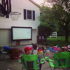 Movie night in the driveway with the best neighbors! Something they will never forget!