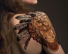 Tribal owl tattoo on shoulder