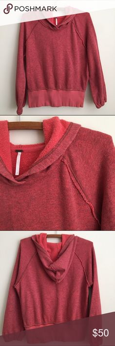 Free People Hoodie Pullover Very cute hoodie! Light reddish color with dark undertones. Size small. Great used condition! 4th photo--next to my finger, darker place in fabric. Not sure from where. Barely noticeable and I actually think it kinda goes with the hoodie's rugged look 😉. Other than that, great Pullover. Free People Tops Sweatshirts & Hoodies