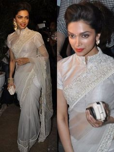 It was a beautiful white saree by Anamika Khanna for the beautiful Deepika Padukone. Big stud earrings, an updo hairstyle, hint of colour with her red lipstick and a tiny bindi. Saree Blouse Patterns, Designer Blouse Patterns, Saree Blouse Designs, Designer Dresses, Lehenga Gown, Saree Dress, Dress Up, Shirt Dress, Blouse Designs High Neck
