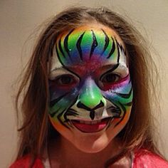Grrrrrrrrrr! Rainbow tiger face paint design. Inspired by Lisa Joy Young and painted by Maddison Ashley / @Maddysmojo