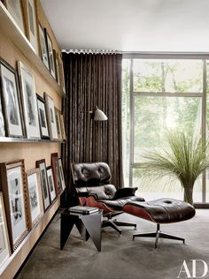 Photographs from the Woodwards' sizable collection are propped against a cork wall in the office, where a vintage Eames lounge chair and ottoman are paired with a vintage Isamu Noguchi side table; the curtains are of a Fabricut fabric | archdigest.com