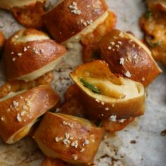 Poppable soft pretzel bites with cheddar cheese and jalapeño slivers peeking out