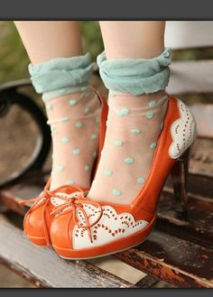 orange heels with white scallop details and sheer sea foam green polk dots socks