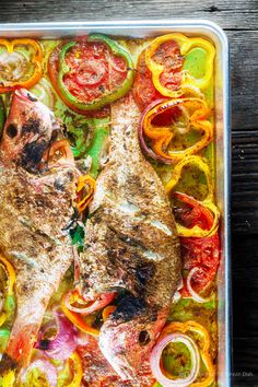Mediterranean Roasted Red Snapper with Garlic and Bell Peppers. Mediterranean Whole Roasted Red Snapper with Garlic and Bell Peppers Fish Dishes, Seafood Dishes, Seafood Recipes, Cooking Recipes, Healthy Recipes, Whole Red Snapper Recipes, Whole Fish Recipes, Baked Snapper, Grilled Red Snapper