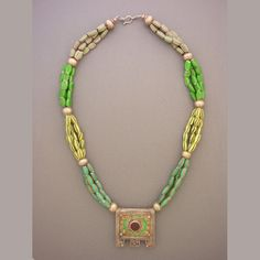 by Anne Holland | Three strands of Venetian glass 'Watermelon' Venetian glass beads from the Africa Trade, ten silver beads from Indonesia and an exquisite enamelled antique Moroccan pendant is amazing. | No Longer Available
