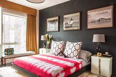 West Chelsea Loft Vacation Rental Bedroom // Charcoal accent wall with surf photography.